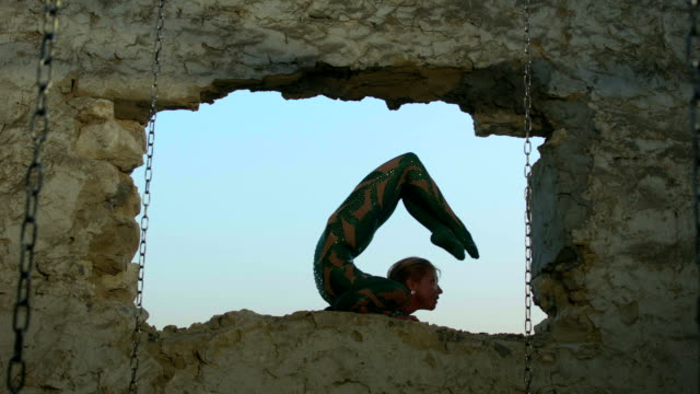 backbend from elbow stand position in old window frame - window frame stock videos & royalty-free footage