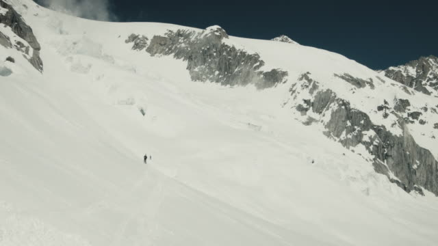 backcountry skier in french alps. - ski jacket stock videos & royalty-free footage