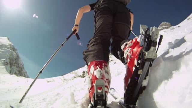 cu la backcountry skier locking down binding and walking uphill / pokljuka, triglav national park, slovenia - telemark stock videos and b-roll footage