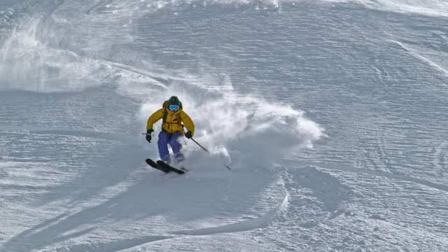 slo mo backcountry skier riding the sunny slope - expertise stock videos & royalty-free footage