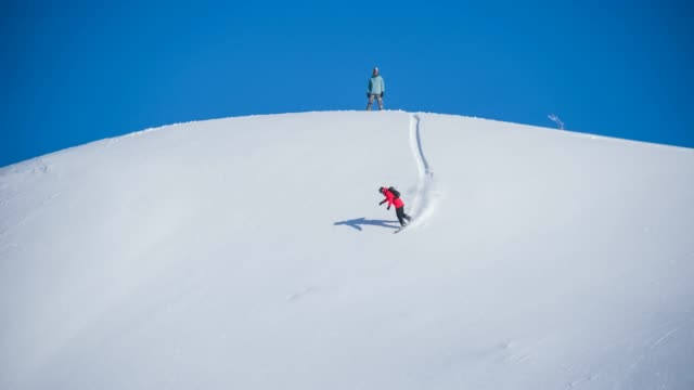 backcountry snowboarding on pristine ski slopes - skiing and snowboarding stock videos and b-roll footage