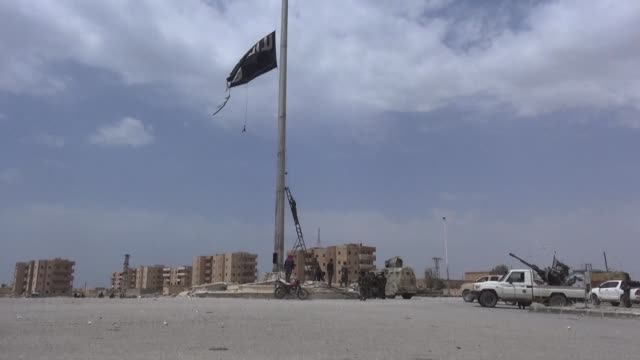 US backed fighters cornered the Islamic State group in a last part of Tabqa on Monday after tearing down a huge jihadist flag that had fluttered over...