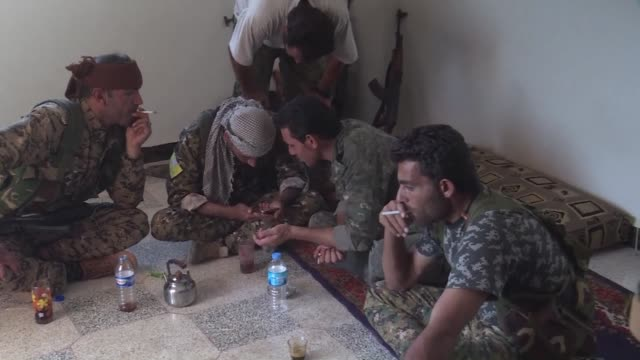 US backed Kurdish and Arab forces continued Thursday to battle jihadists in Raqa the main Syrian stronghold of the Islamic State group with civilians...