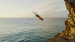 Backflip Cliff Jumping into the Ocean