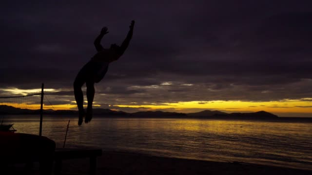 backflip on a perfect sunset - balance stock videos & royalty-free footage