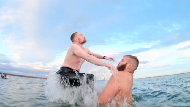 stockvideo's en b-roll-footage met backflips in the sea - messing about