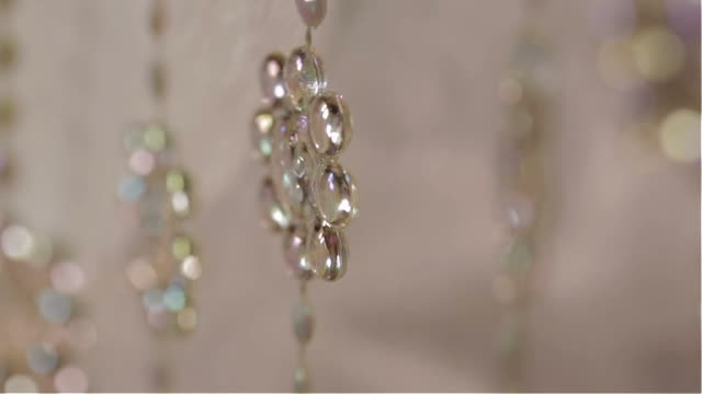 background bead curtain moving white background - beaded curtain stock videos & royalty-free footage