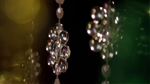 background bead curtain slowly moving with tilt pan - beaded curtain stock videos & royalty-free footage