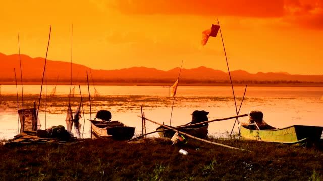 Background boats Fishermen at the lake.