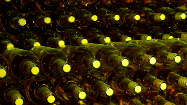 background - bottles of wine and light - wine cellar stock videos and b-roll footage
