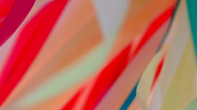 background - chaotic twisting of multi-colored ribbons (slow motion) - multi coloured stock videos & royalty-free footage