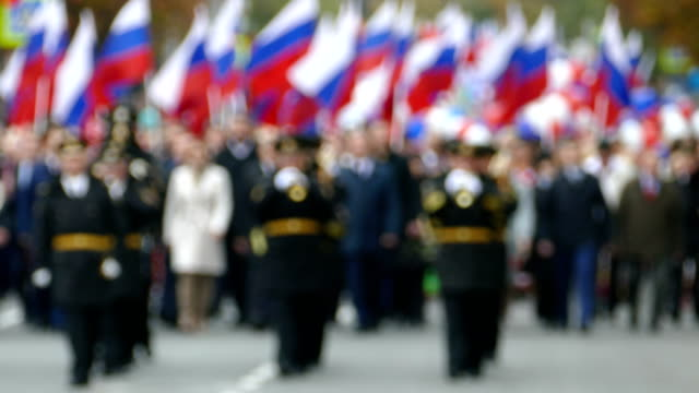 background -  festive procession with a brass band (defocus) - russia stock videos & royalty-free footage