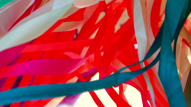background - multi-colored chaos of ribbons (slow motion) - weaving stock videos & royalty-free footage