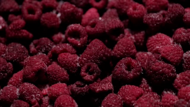 background of frozen raspberries. ripe raspberries with frosty freshness - frozen stock videos & royalty-free footage
