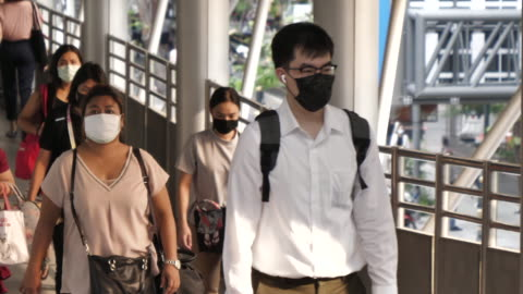 background of people wears mask commuting to work - china east asia stock videos & royalty-free footage