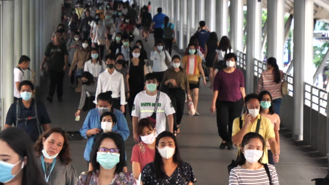 background of people wears mask in thailand - elevated train stock videos & royalty-free footage