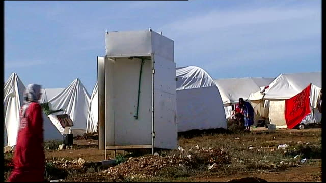 background on british hostage and political dilemma t15111209 / tx various shots tents of makeshift refugee camp with poor hygiene conditions evident... - makeshift stock videos and b-roll footage
