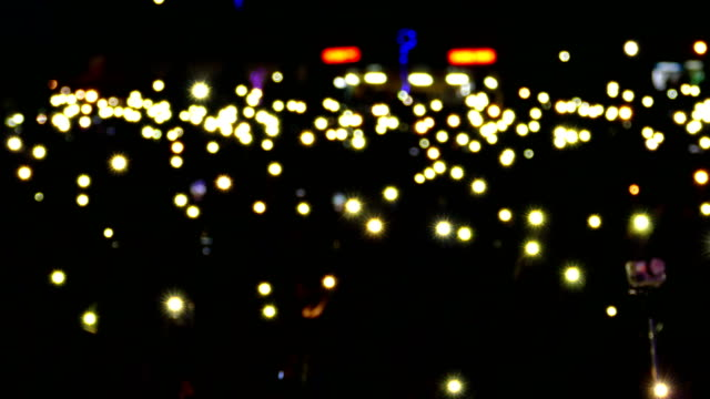 background - people with flashlights of smartphones at a concert - celebrities stock videos & royalty-free footage