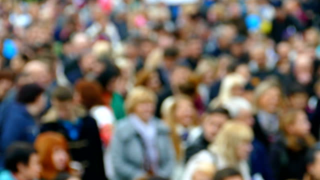 background - procession of people (defocus) - governo video stock e b–roll
