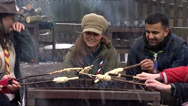 background report on the duchess of cambridge's pregnancy lib / scout camp various shots catherine preparing and cooking damper bread over fire lib /... - メリルボーン点の映像素材/bロール