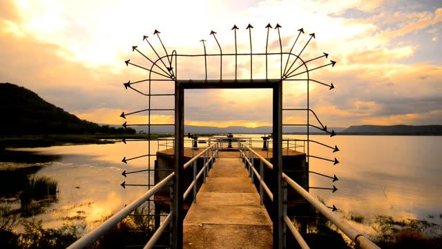 background sunset beautiful at lake. - musical instrument bridge stock videos & royalty-free footage