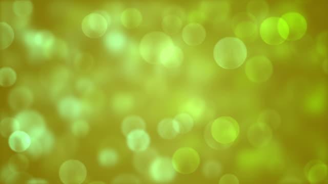vídeos de stock, filmes e b-roll de fundo com círculos de bokeh bonito verde - parélio