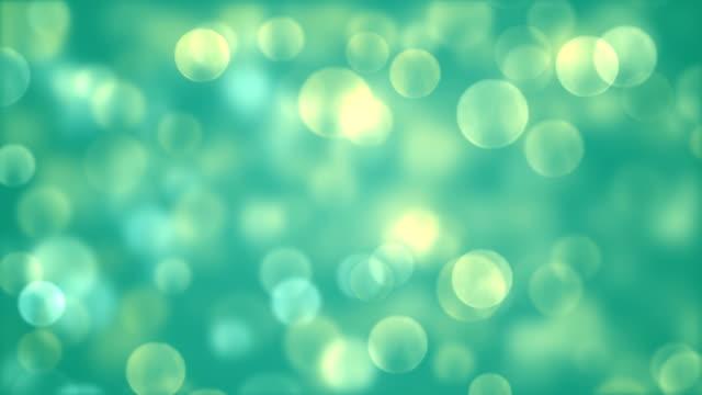 background with beautiful green bokeh circles - sundog stock videos & royalty-free footage