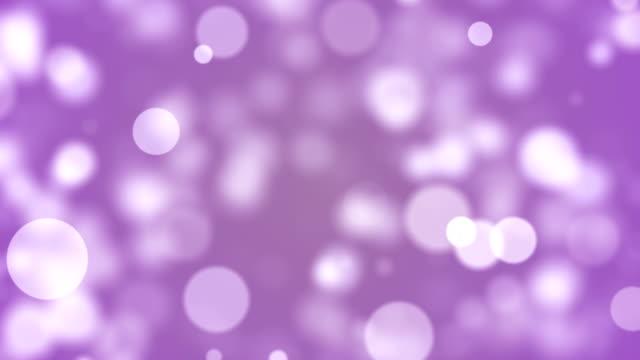 background with beautiful pastel purple bokeh circles - sundog stock videos & royalty-free footage
