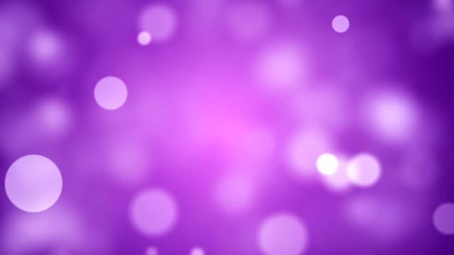 background with beautiful purple bokeh circles - sundog stock videos & royalty-free footage