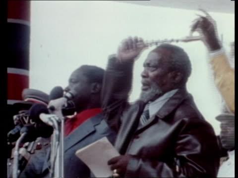 Backgrounder on Kenyan coup attempt KENYA CMS Arap Moi speaking MS Jomo Kenyatta with swish MS Moi towards LMS Walks LR and party CS Oginga Odinga...
