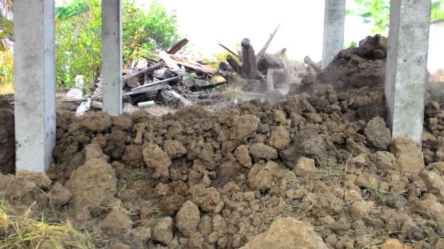 Backhoe bulldozer under the house