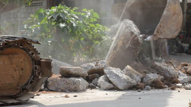 Backhoe destroyed concrete