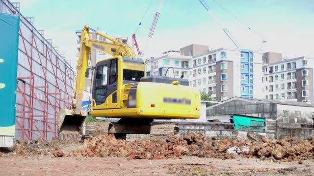 backhoe; excavators machine in construction site on sky background. - mining stock videos & royalty-free footage