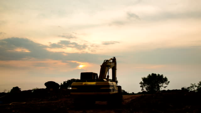 Backhoes and sunset