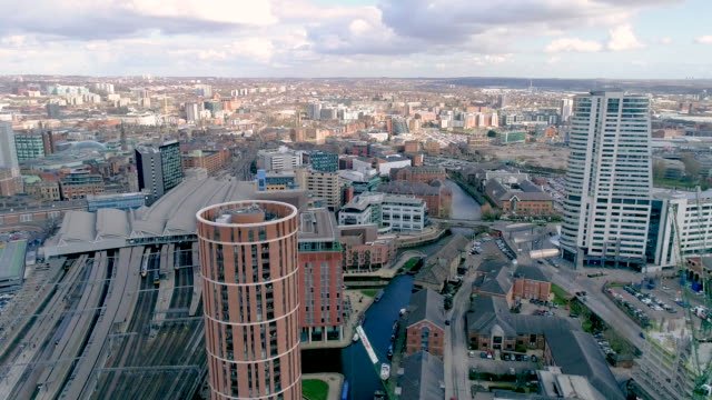 backing away aerial view leeds bridgewater place and candle house apartments - flat stock videos & royalty-free footage