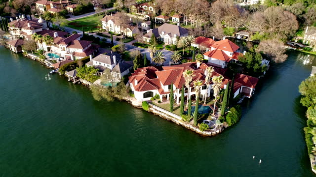 backing away from a million dollar mansion water front property along the riverbanks of the colorado river at mount bonnell park - waterfront stock videos & royalty-free footage