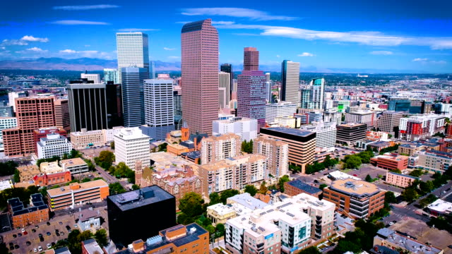 backing away from downtown cityscape skyline of denver colorado - denver stock videos & royalty-free footage