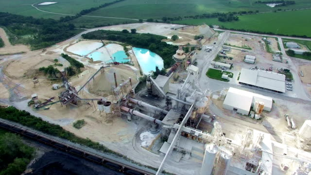 backing away from industrial mill outside of austin texas environmental damage open pit mine factory - opificio video stock e b–roll