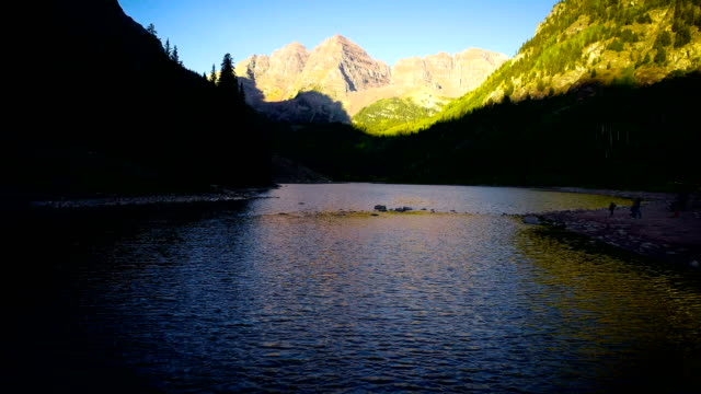 slow motion: backing up maroon bells , aspen , colorado at sunrise - aspen tree stock videos and b-roll footage