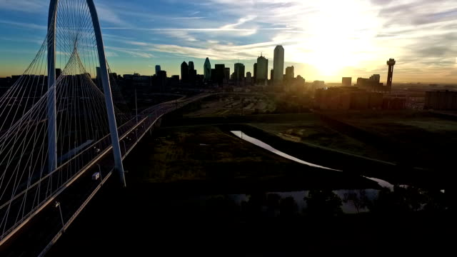 Backing up to view the Entire Dallas Texas Skyline Cityscape and Margaret Hunt Hill Bridge