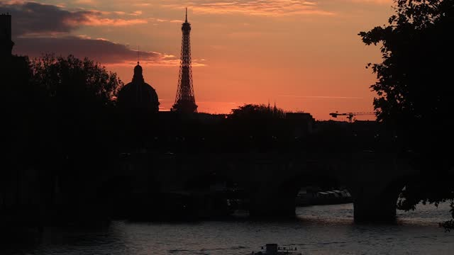 backlight view of the eiffel tower in the late afternoon, an orange sky in the background on september 16 in paris, france. tourism in paris... - atmosphere filter stock videos & royalty-free footage