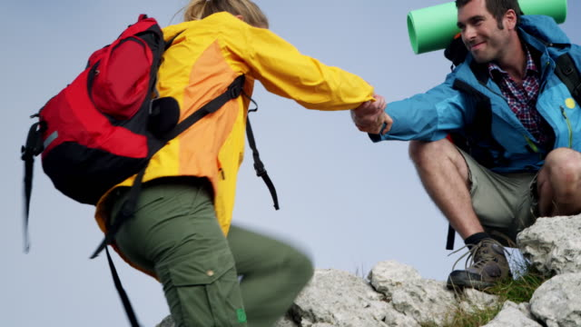 backpacker climbing a mountain - a helping hand stock videos and b-roll footage