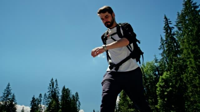 Backpacker crossing mountain river