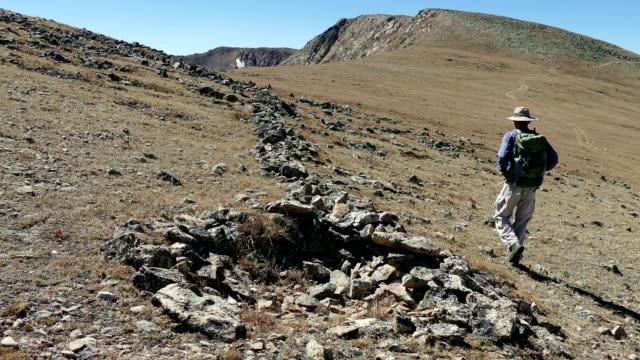 Backpacker hikes Native American game-drive blind James Peak Wilderness Colorado