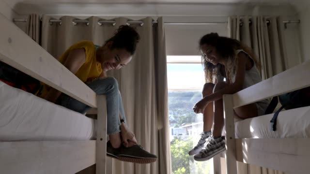 backpackers talking while relaxing on bunkbeds - dorm room stock videos and b-roll footage