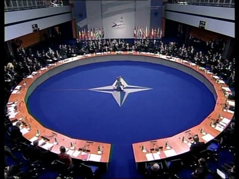 backs disarming of iraq/invites former communist countries to join pool prague tgv nato meeting in progress us president george w bush into room - us president stock videos & royalty-free footage
