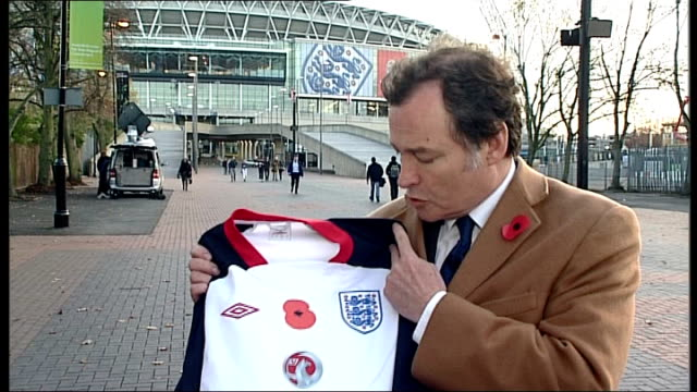 fifa backs down in row over england team wearing poppies england london ext reporter to camera - fifa stock videos and b-roll footage
