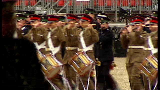 imf backs government's austerity measures horse guards parade ext shots of household division rehearsing the ceremony of beating retreat reporter to... - horse guards parade stock videos and b-roll footage