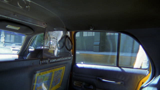 vídeos de stock, filmes e b-roll de backseat passenger point of view young woman getting into taxi and telling driver destination / nyc - interior de transporte