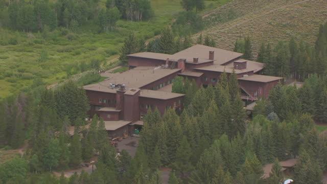 cu aerial backside of house at jackson lake lodge in grand teton national park / jackson wyoming united states - jackson stock videos & royalty-free footage